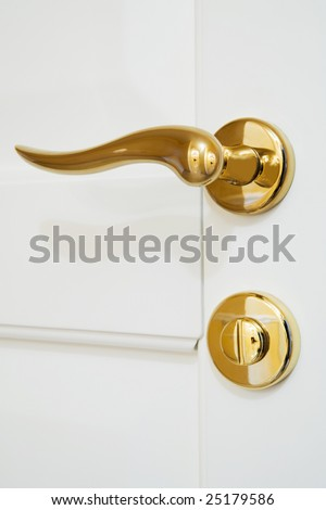 white door with the new shining lock - stock photo