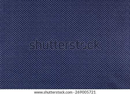 White dots over blue Polka dot fabric background and texture - stock photo