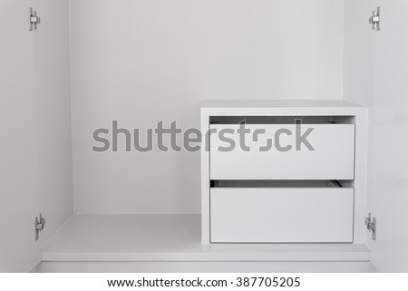 White Drawer in empty cupboard