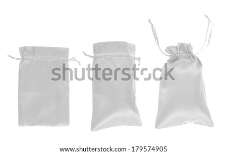 White drawstring bag packaging isolated over white background, set of three images as a process of folding and closing an opened one - stock photo