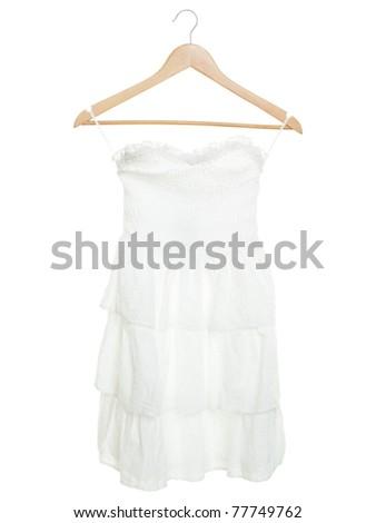 White dress on hanger isolated on white background - stock photo