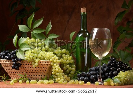 White dry wine, fresh clusters of a grapes - stock photo