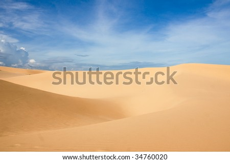 white dunes and blue sky in vietnam - stock photo