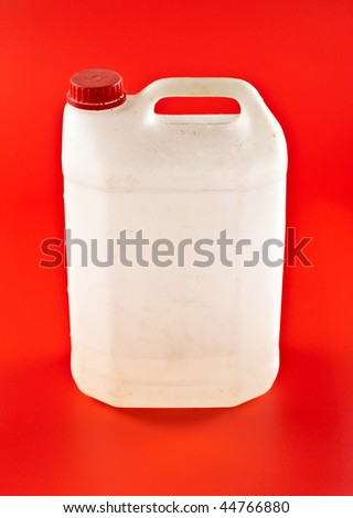 white dusty canister on red background - stock photo