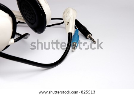 White earbuds isolated on a white background. - stock photo
