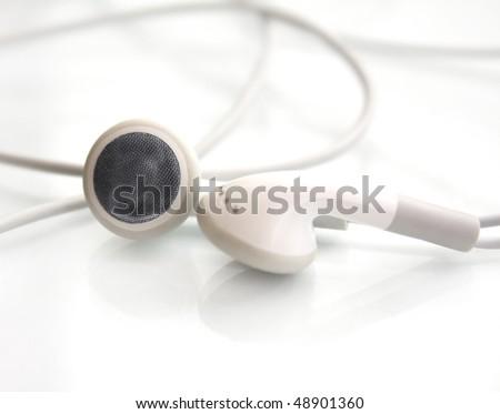 white earphone isolated on white background - stock photo