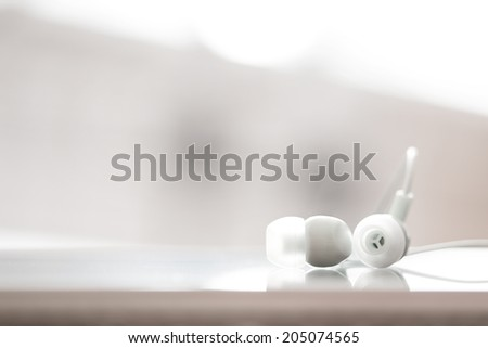 White earphones, close up photo, small dof - stock photo