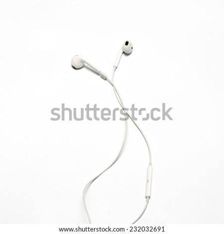 white earphones on a white background - stock photo