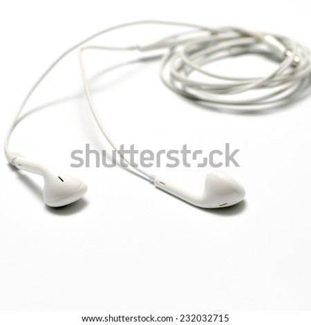 white earphones on a white background