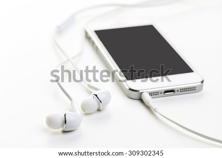 White earphones on white background