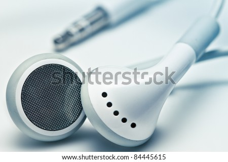 white earphones with the jack - stock photo