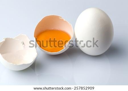 White egg and a half egg - stock photo
