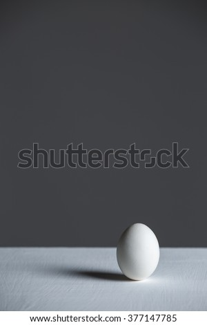 White egg on the white table. Design, visual art, minimalism
