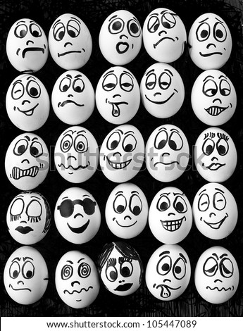 White eggs and  many funny faces - stock photo