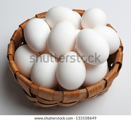 White eggs in a basket - stock photo