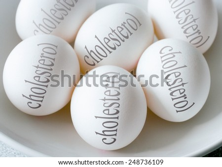 White eggs with Cholesterol text - health and healthy lifestyle  - stock photo