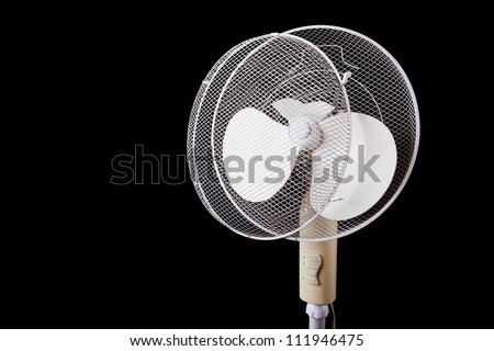 white electric broken fan isolated on black background - stock photo