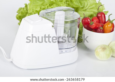 white electric food processor with vegetable - stock photo