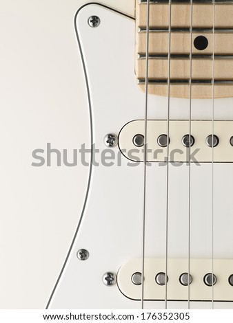 white electric guitar body closeup , for music and entertainment themes - stock photo