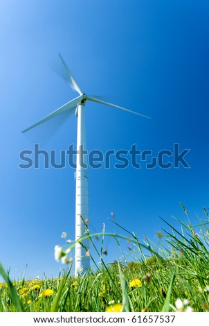 White electricity windmill under clear blue sky - stock photo