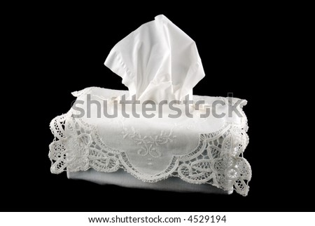 white embroidered box of tissue isolated on black - stock photo