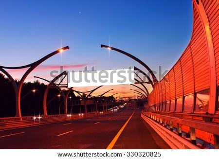 White empty billboard on night highway - stock photo