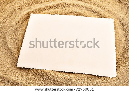 White empty card on a sand. Summer background theme. - stock photo