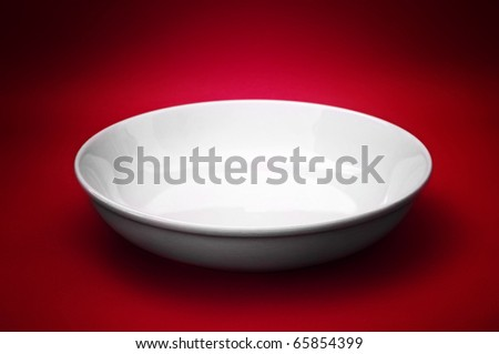 White empty ceramic plate, close up photo - stock photo