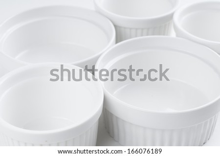 White empty clean ceramic bakeware on a white background, cooking utensils - stock photo