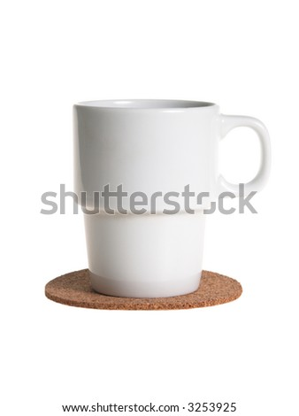 White empty coffee of tea cup on a cork pad isolated on white - stock photo