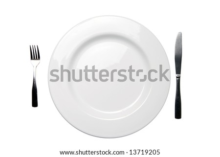 White empty dinner plate with fork and knife - clipping path included - stock photo
