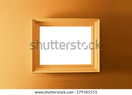 White empty frame on the brown wall. Free copy space. - stock photo