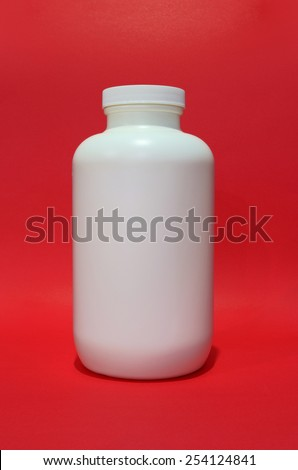 white empty medical container on isolated red background - stock photo