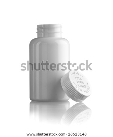 White empty medicine bottle standing with the cap at side - stock photo