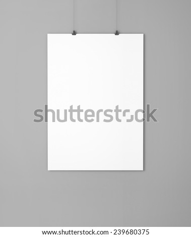 White empty paper with clips on the grey wall - stock photo