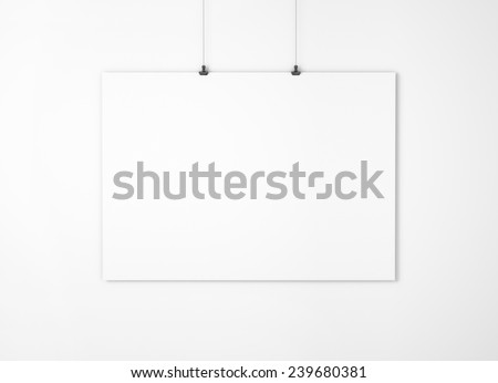 White empty paper with clips on the wall - stock photo