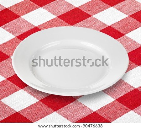 white empty plate on red gingham tablecloth - stock photo