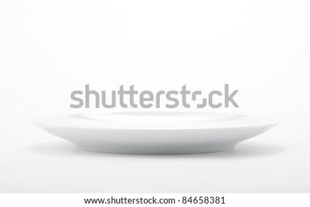 White empty plate on seamless white background. - stock photo