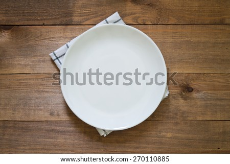 white empty plate on wooden background - stock photo