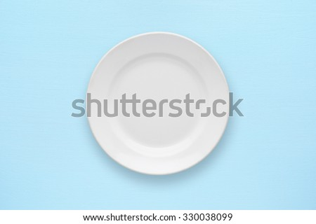 White empty plate top view on table - stock photo