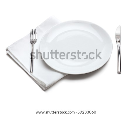 White empty plate with fork and knife - stock photo