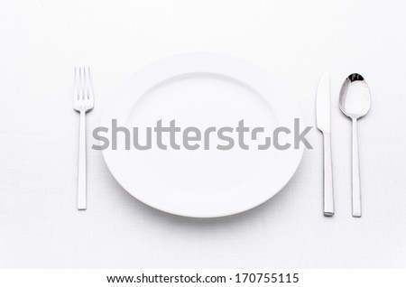 white Empty plate with fork and knife and spoon isolated on white background.  - stock photo