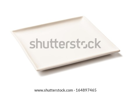 White empty rectangular plate of porcelain on a white background - stock photo