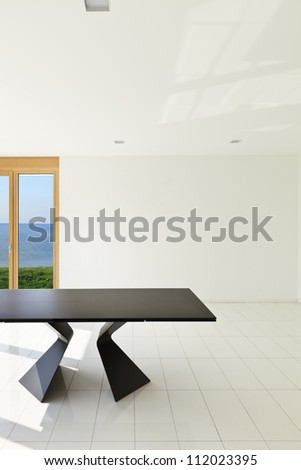 White empty room with black table - stock photo