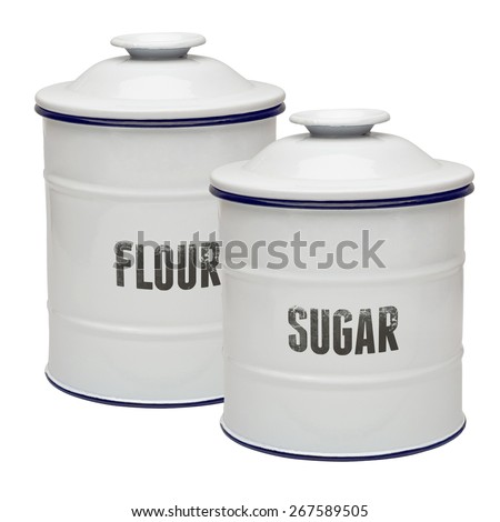 White enamel canisters on white background
