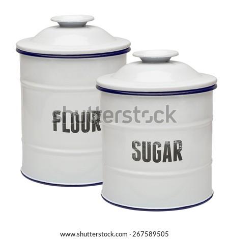 White enamel canisters on white background - stock photo