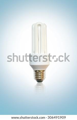 white energy saving bulb, Illuminated light bulb, CFL bulb, Realistic photo image on blue background - stock photo