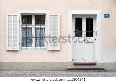 white entrance door with window - stock photo