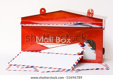 white envelope in red mail box - stock photo