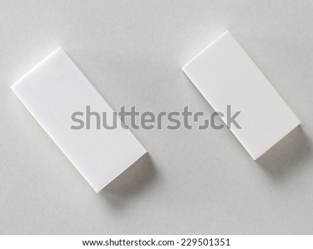 White Erasers isolated on Grey Background with Real Shadow. Top View - stock photo